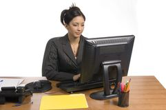 Business is my job. Young business woman behind the desk typing Royalty Free Stock Images