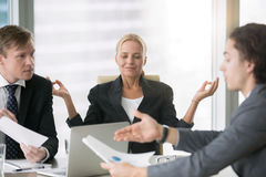 Business negotiation, men arguing, woman meditating Royalty Free Stock Photo