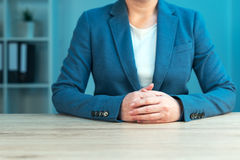 Business negotiation skills with female executive at office desk. Business negotiation skills with female executive sitting at office desk with confident pose Stock Images