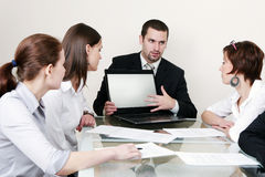 Business Negotiations. Group of people negotiate at the desk Royalty Free Stock Photos