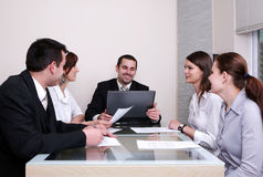 Business Negotiations. Group of people negotiate at the desk Stock Photos