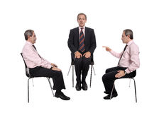 Business negotiations. Business negotiation - Two businessmen discussing and a moderator isolated on white stock image