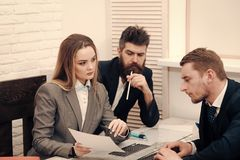 Business negotiations concept. Business partners, businessmen at meeting, office background. Woman lawyer explain terms. Of transaction. Business negotiations Royalty Free Stock Photos