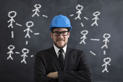 Business Network. Engineer Posing Front Of The Blackboard Royalty Free Stock Photo