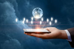 Business network in mobile devices . royalty free stock photos