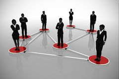 Business network of executives interconnected and standing on discs. A business network of successful executives in silhouettes standing on interconnected discs Royalty Free Stock Image