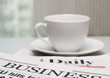 Business Newspaper And A Cup Of Coffee Royalty Free Stock Photo