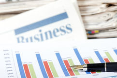 Business the newspaper with chart Royalty Free Stock Photography