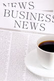 Business newspaper and  cup of coffee Stock Photography