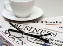 Business newspaper and a cup of coffee Royalty Free Stock Photography