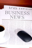 Business newspaper, cup of coffee and mouse Royalty Free Stock Photos