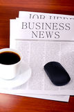 Business newspaper, cup of coffee and mouse Royalty Free Stock Image