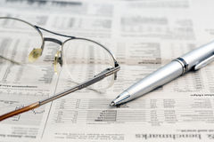 Business newspaper and glasses Stock Photo