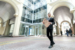 Business newspaper. Successful young man in formal wear holding Stock Image
