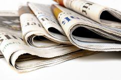 Business Newspapers. Various newspapers over white background Royalty Free Stock Images
