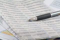 Business newspapers and pen Stock Images