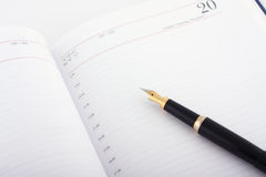 Business note. Business symbols - Agenda and pen royalty free stock photo