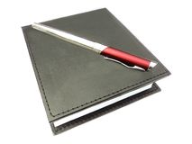 Business note book and ballpoint Stock Photos