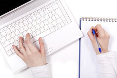Business notebook with laptop and pen in hand. Royalty Free Stock Images