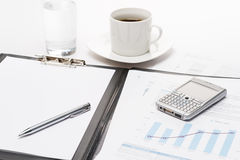 Business notepad phone and cup of coffee Stock Photography