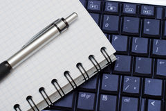 Business objects. Pen, diary and a keyboard. Business background for any use Royalty Free Stock Images