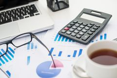 Business objects. Close-up shot of office objects and statistical documents Royalty Free Stock Photography