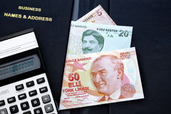 Business objects. Black leather diary with bills and calculator Royalty Free Stock Photography