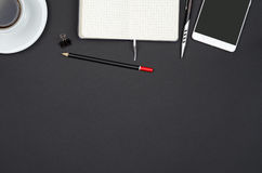 Business objects on a black desk. Royalty Free Stock Photos