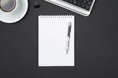 Business objects on a black desk. Stock Photos
