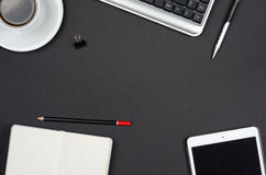 Business objects on a black desk. Royalty Free Stock Photo