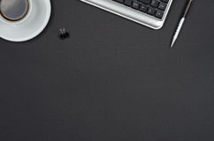 Business objects on a black desk. Royalty Free Stock Image