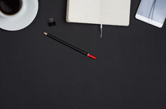 Business objects on a black desk. Royalty Free Stock Photography