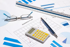 Business objects - graphs, charts, pen and calculator Royalty Free Stock Photo