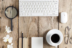 Business objects of keyboard,mouse,white coffee cup,white paper, Royalty Free Stock Photo