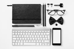 Business objects in order on white desk. Royalty Free Stock Photo