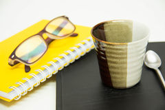 Business objects  papers  cups of coffee  glasses Royalty Free Stock Image