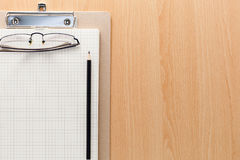 Business objects of pencils,white paper note and glasses on wood Stock Image