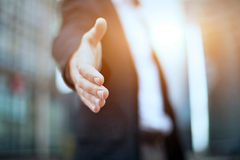 Business offer. Businessman offering handshake and partnership Royalty Free Stock Images