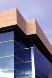 Business office building. Business building with blue windows royalty free stock photography