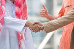 Business and Office concept - Arab and business man are shaking. Hand on cityscape background Stock Image