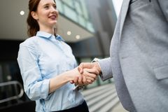 Business and office concept. Businessman and businesswoman shaking hands royalty free stock photos