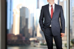 Business and office concept -  elegant young fashion  buisness man in  a blue/navy suit.  Royalty Free Stock Photos