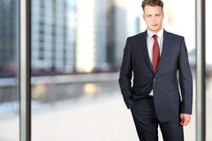 Business and office concept -  elegant young fashion  buisness man in  a blue/navy suit.  Royalty Free Stock Photography
