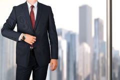 Business and office concept - elegant young fashion business man in a blue/navy suit Stock Photos
