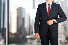 Business and office concept - elegant young fashion business man in a blue/navy suit Royalty Free Stock Photos