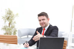 Business and office concept - handsome businessman with hand ready for handshake. Business and office concept - handsome businessman with open hand ready for Stock Image