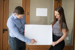 Business and office concept - happy business team in office with white blank board.  Royalty Free Stock Images
