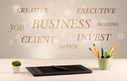 Business office desk with writing on wall Stock Photo