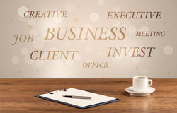 Business office desk with writing on wall Royalty Free Stock Images
