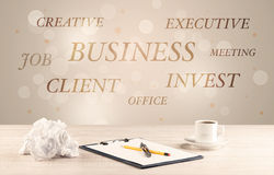 Business office desk with writing on wall Stock Photos